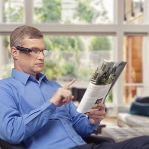 Man Using an OrCam Device to Read